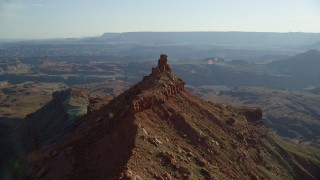 AX138_176 - 6K stock footage aerial video orbit small butte with wide view of Canyonlands National Park, Utah