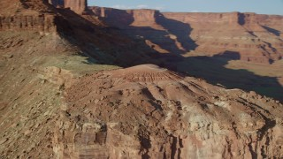 AX138_186 - 6K stock footage aerial video orbit a small domed butte in Moab, Utah
