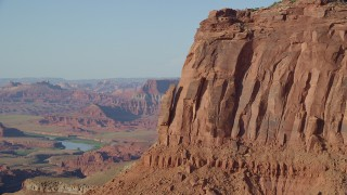 AX138_192 - 6K stock footage aerial video approach a cliffside rock formation in Moab, Utah