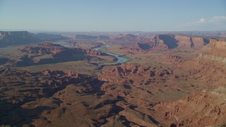 AX138_194 - 6K stock footage aerial video of the Colorado River through the Moab desert with buttes and mesas, Moab, Utah