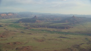 AX138_258 - 6K stock footage aerial video approaching South Six-Shooter Peak, North Six-Shooter Peak in a hazy valley, Moab, Utah