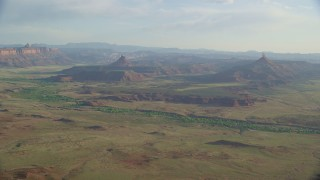AX138_259 - 6K stock footage aerial video of approaching South Six-Shooter Peak and North Six-Shooter Peak, Moab, Utah