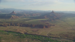 AX138_260 - 6K stock footage aerial video of an approach to North Six-Shooter Peak beside South Six-Shooter Peak, Moab, Utah