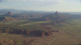AX138_261 - 6K stock footage aerial video slowly approach North Six-Shooter Peak, South Six-Shooter Peak in hazy valley, Moab, Utah