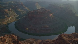 AX138_292 - 6K stock footage aerial video of The Loop East part of Meander Canyon and Colorado River, Canyonlands National Park, Utah, sunset