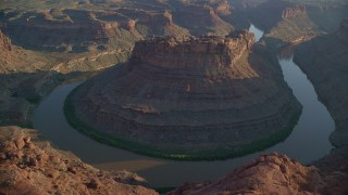AX138_293 - 6K stock footage aerial video of slow orbit of The Loop East in Meander Canyon and Colorado River, Canyonlands National Park, Utah, sunset
