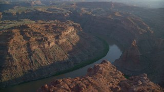 AX138_296 - 6K stock footage aerial video pass The Loop West in Meander Canyon, and Colorado River, Canyonlands National Park, Utah, sunset