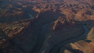 AX138_303 - 6K stock footage aerial video of The Loop West, The Loop East parts of Meander Canyon and Colorado River, Canyonlands National Park, Utah, sunset