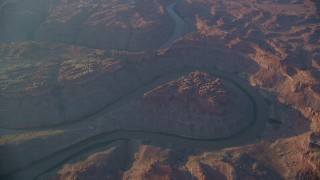 AX138_328 - 6K stock footage aerial video of orbit The Loop East and river at bottom of Meander Canyon, Canyonlands National Park, Utah, sunset