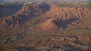 AX138_345 - 6K stock footage aerial video of approaching a butte and box canyon cliffs in Lockhart Canyon, Moab, Utah, sunset