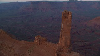 AX138_418 - 6K stock footage aerial video orbit Castleton Tower in Moab, Utah, at sunset