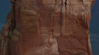 AX138_419 - 6K stock footage aerial video of orbiting rock climber on Castleton Tower, Moab, Utah, sunset