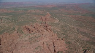 AX139_001 - 6K stock footage aerial video of flying over rock formations and desert valley, Arches National Park, Utah