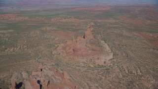 AX139_002 - 6K stock footage aerial video of approaching desert rock formations in desert valley, Arches National Park, Utah