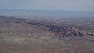 AX139_003 - 6K stock footage aerial video of flying by Devil's Garden in Arches National Park, Utah