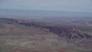 AX139_004 - 6K stock footage aerial video of passing by Devil's Garden in Arches National Park, Utah