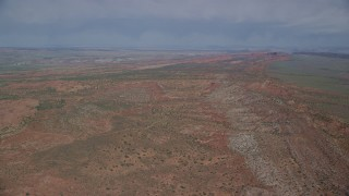 AX139_005 - 6K stock footage aerial video of flying over open desert in Arches National Park, Utah