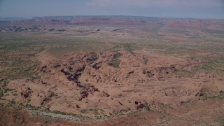 AX139_006 - 6K stock footage aerial video of flying by desert rock formations, Arches National Park, Utah