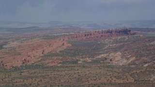 AX139_008 - 6K stock footage aerial video of flying by Devil's Garden rock formations, Arches National Park, Utah