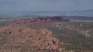AX139_011 - 6K stock footage aerial video of flying by rock formations in Devil's Garden, Arches National Park, Utah