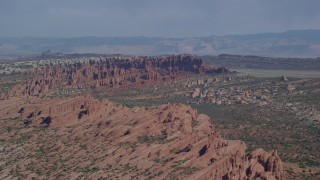 AX139_012 - 6K stock footage aerial video of passing by rock formations at Devil's Garden, Arches National Park, Utah