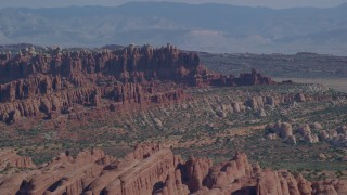 AX139_013 - 6K stock footage aerial video of rock formations at Devil's Garden, Arches National Park, Utah