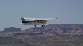 AX139_023 - 6K stock footage aerial video of tracking Cessna flying over desert, Grand County, Utah