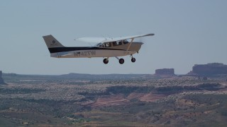AX139_025 - 6K stock footage aerial video of tracking a Cessna flying over the desert, Grand County, Utah