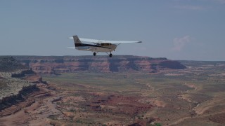 AX139_026 - 6K stock footage aerial video of tracking a Cessna over open desert, Grand County, Utah