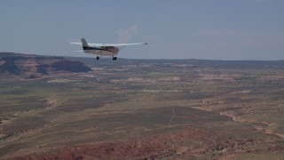 AX139_027 - 6K stock footage aerial video of tracking Cessna flying over desert in Grand County, Utah