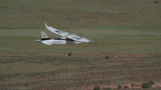 AX139_034 - 6K stock footage aerial video of a Tecnam P2006T flying over the desert, Grand County, Utah