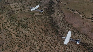 AX139_043 - 6K stock footage aerial video of a Tecnam P2006T and Cessna flying over desert, Grand County, Utah
