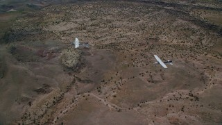AX139_044 - 6K stock footage aerial video of Tecnam P2006T and Cessna flying together over desert, Grand County, Utah