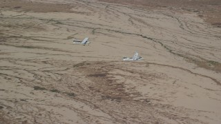 AX139_051 - 6K stock footage aerial video of Tecnam P2006T, Cessna airplanes flying over desert, zoom in, Grand County, Utah