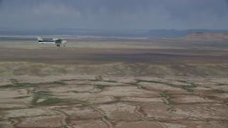 AX139_061 - 6K stock footage aerial video focus on Cessna over desert, reveal Tecnam P2006T, Grand County, Utah