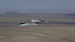 AX139_062 - 6K stock footage aerial video of a Tecnam P2006T flying over desert, Grand County, Utah