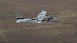 AX139_065 - 6K stock footage aerial video of tracking Tecnam P2006T airplane flying over desert, Grand County, Utah