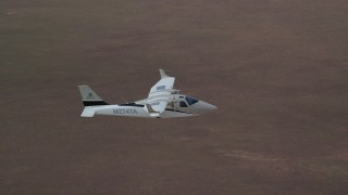 AX139_066 - 6K stock footage aerial video of Tecnam P2006T airplane flying over desert, Grand County, Utah