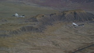 AX139_071 - 6K stock footage aerial video of Tecnam P2006T, Cessna over desert near a highway, Grand County, Utah