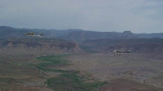 AX139_074 - 6K stock footage aerial video of Tecnam P2006T and Cessna aircraft in Grand County, Utah
