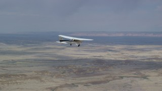 AX139_080 - 6K stock footage aerial video of tracking Cessna over desert, reveal Tecnam P2006T, Grand County, Utah