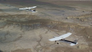 AX139_084 - 6K stock footage aerial video of flying near Tecnam P2006T and Cessna over desert, Grand County, Utah