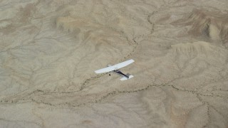 AX139_086 - 6K stock footage aerial video of an air to air view of a Cessna flying over desert, Grand County, Utah