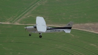 AX139_095 - 6K stock footage aerial video focus on a Cessna airplane over circular crop fields, Green River, Utah