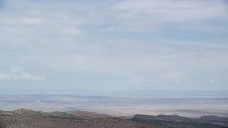 AX139_119 - Aerial stock footage of Tracking Cessna flying over desert ridges, Emery County, Utah