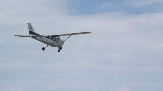 AX139_122 - Aerial stock footage of Tracking Cessna flying high above desert, Emery County, Utah