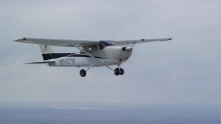AX139_124 - Aerial stock footage of Tracking Cessna flying high above desert, Emery County, Utah