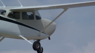 AX139_135 - Aerial stock footage of Tracking Cessna flying high above desert, closeup of cockpit, Emery County, Utah