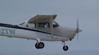 AX139_144 - 6K stock footage aerial video of a Cessna over desert mountains, closeup on cockpit, Carbon County, Utah