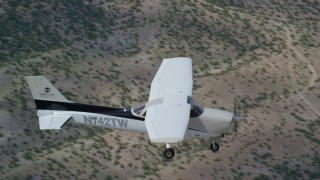 AX139_147 - 6K stock footage aerial video of a view of a Cessna over desert mountains, seen from above, Carbon County, Utah